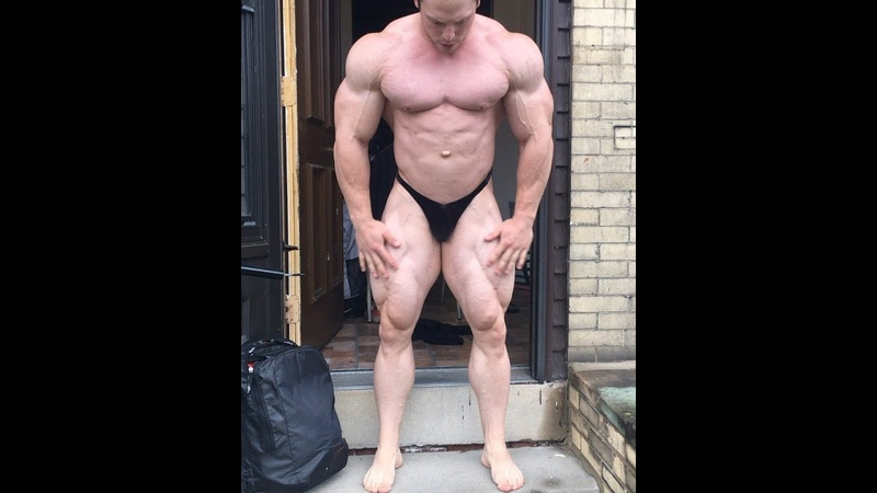 Young big bulged pale skinned muscle god Martin Fitzwater United States practices in tight posers