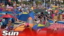 Beaches packed on UK's hottest day despite distancing rules